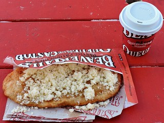 Garlic butter and cheese beavertail; hot apple cider