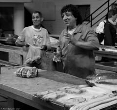 Fresh off the boat this morning. (Neil. Moralee) Tags: madeieaneilmoralee fish market man men work working sell selling fishmonger slab tuna scabbard fishes smile happy face mature old fresh black white blackandwhite bw mono monochrome lowlight nikon d7100 neil moralee madeira funchal portrait menatwork cut