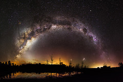 Milky Way over Harvey Dam, Western Australia (inefekt69) Tags: westernaustralia australia great rift panorama stitched msice landscape wide magellanicclouds magellanic clouds largemagellaniccloud smallmagellaniccloud astrophotography astronomy stars galaxy milkyway galactic core space night nightphotography nikon 35mm d5100 dslr longexposure perth southern southernhemisphere cosmos cosmology outdoor sky landscapeastrophotography harvey dam water reflections trees deadtree etacarinae carinanebula explored explore