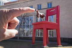 Forced perspective 2 (Sally Harmon Photography) Tags: forcedperspective perspective red horse denverlibraryredchair chair redchair point giantorsmall giant tinyhorse dogwood2017 dogwood2017week10