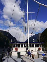 photo - The Bridge of the Milford Mariner (Jassy-50) Tags: photo milfordmariner shipsbridge bridge milfordsound fjord newzealand fiordlandnationalpark mountain nationalpark southisland tewāhipounausouthwestnewzealandworldheritagearea tewahipounausouthwestnewzealandworldheritagearea tewāhipounau tewahipounau unescoworldheritagesite unescoworldheritage unesco worldheritagesite worldheritage whs shipsmast mast bench hubby ship boat lifesaver shipsrail