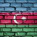 National Flag of Azerbaijan on a Brick Wall