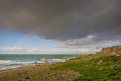 Rainbow over Hovs Hallar (Fredde Nilsson) Tags: blue red sea green water grass rain stone clouds grey se skne rainbow waves wind sweden double foam scania hovshallar granit bstad skneln bjre