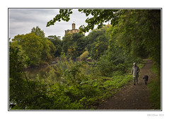 Castle View (Seven_Wishes) Tags: uk trees plants dog building castle water landscape person path foliage northumberland riverbank warkworthcastle newcastleupontyne dogwalker tyneandwear overhangingtrees earlyautumn rivercoquet canonef24105mmf4lis edoliver photoborder 7wishes canoneos5dmark3 newcastleupontynenortheast 7wishesphotography