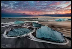 Iced Over [Explored] (Aaron M Photo) Tags: 2015 aaronmeyers aaronmeyersphotography atlanticocean bredamerkurjokull breiã°amerkurjã¶kull d800 europe glacier glacierlagoon iceland jokulsarlon jã¶kulsã¡rlã³n march nationalpark nikon nikond800 northern reynivellir sunset vatnajokull vatnajã¶kull aurora auroraborealis beach beautiful beauty blacksand blacksandbeach clouds exploring frozen ice icebeach icechunks icelagoon iceberg insane lagoon lake landscape lights longexposure nature night nightscape northernlights ocean photovacation scenic sky snow stunning travel vacation waves winter