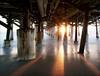 Snaggle-tooth pier. (Jill Bazeley) Tags: cocoabeach florida usa a6300 sony 1018mm sel1018 cocoa beach pier cape canaveral sunrise dawn sun star long exposure piling brevard county atlantic ocean sunstar sunburst architecture column