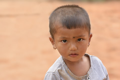 big eyes (still very busy, trying to catch up) Tags: kid nepal nepali nepalikid travel remote look portrait ivodedecker