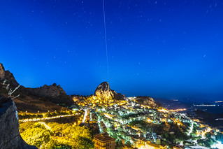The International Space Station (ISS) surfs the sky above Caltabellotta.