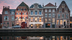 Tour de Haarlem (McQuaide Photography) Tags: haarlem noordholland northholland netherlands nederland holland dutch europe sony a7rii ilce7rm2 alpha mirrorless 1635mm sonyzeiss zeiss variotessar fullframe mcquaidephotography adobe photoshop lightroom tripod manfrotto light licht availablelight dusk twilight schemering bluehour water reflection longexposure stad city urban river riverside spaarne waterside lowlight outdoor outside waterfront architecture skyline building gebouw calm peaceful tranquil winter house houses huis huizen 169 widescreen colour color colourful row windows facade classic authentic traditional dutcharchitecture restaurant brasserie brasserietourdefrance wideangle groothoek inarow