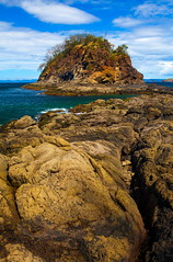The Island (stevenbulman44) Tags: pacificocean costarica playadelcoco beach rock volcanic canon holiday 2470f28l filter polarizer dof sky cloud blue fissure