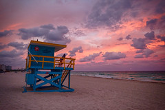 Sunset in Miami Beach (` Toshio ') Tags: toshio miami miamibeach florida sunset lifeguard lifeguardtower clouds beach atlantic ocean atlanticocean sand woman fujixe2 xe2