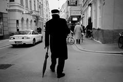walk the Walk (joaobambu) Tags: vienna wien street bw white man black umbrella walking austria österreich europa europe pedestrian walker