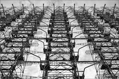 "Duga-3 a.k.a. ""Russian Woodpecker"" (Bert Kaufmann) Tags: bw abandoned blackwhite woodpecker zwartwit nuclear ukraine disaster kyiv antenne antenna radar duga shortwave chernobyl urbex amateurradio verlaten desolaat oblast pripyat exclusionzone chornobyl urbexing prypyat nucleardisaster tsjernobyl oekrane zoneofalienation missiledetectionsystem chernobylnuclearpowerplant pripjat kernramp    chernobyldisaster giantantenna 10hz duga3 krasnoye russianwoodpecker othradar radarsysteem chernobylnuclearpowerplantzoneofalienation doega3 therussianwoodpecker  zagorizontnajaradiolokatsionnajastantsiadoega doega"