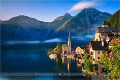 Sunrise in Hallstatt - Austria (~ Floydian ~ ) Tags: longexposure morning sun mountain lake mountains alps sunrise canon landscape photography dawn austria town village sunny le warmlight salzkammergut movingclouds hallstatt upperaustria hallstttersee floydian leefilters canoneos1dsmarkiii henkmeijer bigstopper