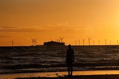 Ferry over the sea (Tony Shertila) Tags: 20150827221915 blundellsands blundellsandsward england gbr geo:lat=5348117627 geo:lon=304615259 geotagged unitedkingdom europe britain merseyside liverpool crosby anotherplace anthonygormley statue weather night clear sunset ship sea coast irishsea transport turbine windmill sand shore