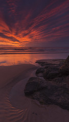 Sunrise on the rocks 2 (adamcaird) Tags: canon canon6d colourful water outdoor orange scotland seaside sunrise reflection red clouds sea sand waves landscape seascape outdoors ngc cokin filter exposure canon16mm35mm