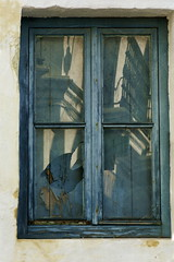 Reflections of Conil - HWW! (suzanne~) Tags: window spain conil andalusia town outdoor wroughtiron reflection balcony blue broken glass
