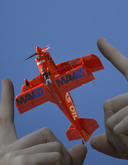 Fly By (swong95765) Tags: airplane biplane flyer flying plane propeller stunt sky hands fingers frame