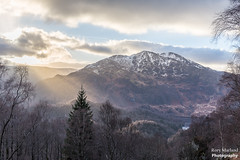 A warming ray over a snow capped Ben Venure, Scotland (Rory Marland) Tags: colourimage visitscotland tradition composition landscape winter bushes tranquillity nowhere clouds outdoor hdr rayoflight sunset sunshine glen travel sun hiking rorymarland f8 photography rays tourism uk mountain highlandregion trossachs northscotland tranquility colours sharp peaceful cold snow 6d highlands calm hills hill postcard light haze lochkatrine sunrays 2470mm scotland ray hidden north golden highland colors intense smooth multicolour outdoors dramatic