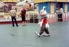 The White Rabbit walking by Dumbo the Flying Elephant, 1962 (Tom Simpson) Tags: disney disneyland vintage vintagedisney vintagedisneyland 1962 1960s aliceinwonderland whiterabbit thewhiterabbit
