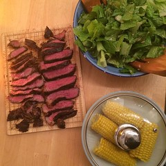 Steak, salad and corn.