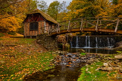 The Gomez Mill (Strykapose) Tags: longexposure bridge autumn roof newyork fall colors leaves clouds creek afternoon dam country cottage foliage historical orangecounty waterwheel thatched newburg relic papermill rrs ulstercounty nationalregisterofhistoricplaces bh55 woodenfootbridge dardhunter peakbloom gomezmillhouse luismosesgomez strykapose tvc34l 5dsr formattfirecrest thegomezmill
