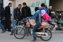 Collecting free bread in Ariha, Idlib (Ummah Welfare Trust) Tags: poverty children war islam aid hunger arab syria humanitarian إدلب، سوريا
