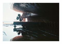 034_34 (jimbonzo079) Tags: cruise dock drydock port harbor harbour marine maritime naval ship vessel boat propeller color colour art rust retro vintage europe industry industrial world engineering shipyard hellas greek greece kodak ektar 25 phr expired film iso25 frame attiki negative analog canon ae1 fd 50mm f18 lens 35mm scan slr landscape topography 2016 water reflection