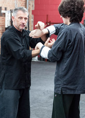 """SIfu Trevor Haines Practicing """"Chi Sau"""" with a young student (rpennington9) Tags: kungfu tennessee chattanooga nikon wingchun martialarts internalenergy chisau stickyhands"""
