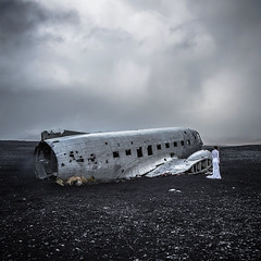 The bride and the DC-3 wreck (cpphotofinish) Tags: plane wreck sólheimasandur 1973 united states navy douglas super dc3 airplane iceland abandoned water weather beach eos5dmk3 canon cpphotofinish carstenpedersen canondslr carst1 canon5dmk3 canonredlable black monochrome ef24105mmf4lisusm
