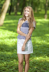 Teenagers Concepts. Portrait of Blond Caucasian Teenager Girl Posing Outside in Green Forest (DmitryMorgan) Tags: 1 1319years attractive beautiful blond blondyhair casual caucasian cheerful concept cute day enjoying female forest happy holidays joyful leisure leisureactivity lifestyle lifetime lovely one outdoors park positive relaxing skirt smiling standing stripe stripy stylish summer sunglasses sunny teen teenager vacation white younggirl youth