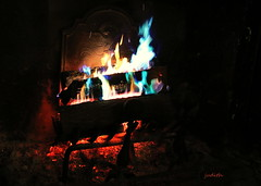 put another log on the fire -- it's the little things (judecat ( settling in for the winter)) Tags: fire fireplace burning colorfulflames warm itsthelittlethings