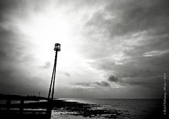 Sun Burst (rhfo2o - rick hathaway photography) Tags: sea sky blackandwhite bw sun beach clouds sunrise mono seaside westsussex lowtide groyne iphone rustington groynemarker iphone4s rhfo2o