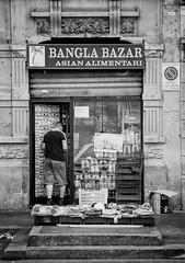 Bazar in Milan (nickriviera73) Tags: street blackandwhite bw italy milan film 35mm reflex kodak voigtlander bazar filmscan retina dynarex