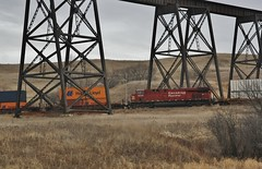 Mid-Train - Valley City, ND (MinnKota Railfan) Tags: santa city railroad trestle bridge car burlington train high power pacific north engine rail railway loco canadian line well container valley nd hi locomotive fe northern dakota freight bnsf divided girder unit truss intermodal dpu