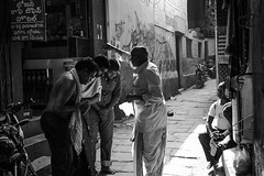 Blessing (Sauvik.Acharyya) Tags: street light shadow people india men blessings photography blackwhite day action places spiritual emotions sauvikacharyya