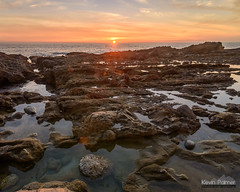 At the Horizon (kevin-palmer) Tags: lagunabeach victoriabeach orangecounty california december winter pacificocean waves water evening sunset nikond750 color colorful lowtide tidepools tokina1628mmf28 clouds orange yellow gold golden rocks hdr