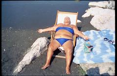 (High Noon) (Robbie McIntosh) Tags: leicamp leica mp rangefinder streetphotography 35mm film pellicola analog analogue negative leicam analogico dyi selfdeveloped filmisnotdead autaut candid tetenalcolortecc41 strangers cinestill50d cinestill 50 summilux leicasummilux35mmf14i summilux35mmf14i leicasummilux35mmf14 summilux35mmf14preasph pose portrait beach summer sea woman fat bikini belly lidomappatella mappatellabeach