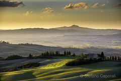 Val d'Orcia, Tuscany (Stefano Caporali) Tags: valdorcia valley field clouds country countryhouse countryside cypress sky sunrise morning tuscany rollinghills rural hills sanquiricodorcia italy