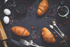 Croissants, coffee and chocolate (Arx0nt.) Tags: food coffee chocolate drink morning breakfast pastry croissant vintage dark toned retro nuts spices cinnamon vanilla eggs cutlery silverware top view table stone background copy space eat dessert delicious snack still life horizontal overhead
