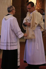 Fr. Rouch invests the new deacon with the dalmatic and stole.