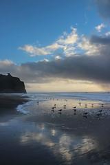 pomponio beach reflection (j j miller) Tags: ocean california ca sunset storm reflection beach rain clouds coast dusk lowtide cloudporn hwy1 californiacoast pomponio statebeach pomponiostatebeach