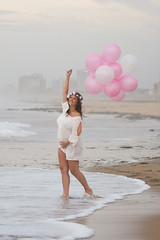 Pink for Zoey (haddartist) Tags: ocean light portrait woman white blur flower beach beautiful beauty smile misty standing buildings balloons happy virginia stand sand holding surf mood afternoon dress photoshoot cloudy bokeh pregnancy naturallight pregnant textures belly maternity oceanside foam crown hotels virginiabeach photosession oceanfront filteredlight 68thstreet amphotography