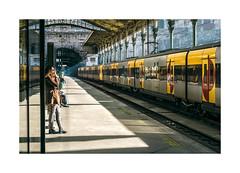 Estação de São Bento, Porto (Sr. Cordeiro) Tags: street shadow sun sol portugal station train 35mm waiting fuji porto fujifilm f2 rua fujinon espera oporto wr estação comboios xf sãobento estaçãodesãobento somba xpro1