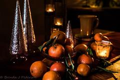 Winter Citrus (Culinary Fool) Tags: tree candle citrus 2017 23mm culinaryfool mandarin brendajpederson orange january pitcher stilllife lowlight satsuma holiday shears