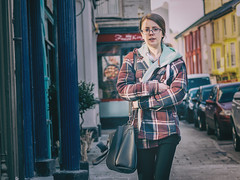 She wears Glasses. (Howie Mudge LRPS) Tags: woman girl candid casual portrait photography photographer street streetphotography streetlife streetstyle urban urbanphotography style pavement houses doors windows bokeh bokehful bokehlicious pretty myownstyle aberystwyth ceredigion wales cymru uk panasonic lumix microfourthirds micro43 micro43mountlenses mft m43 color colour panasonicdmcg80 lumixg425f17