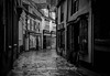 Grape Lane, empty & wet (jameshowardphotography) Tags: england empty lane street streets shops mono monochrome black whitby white yorkshire north northyorkshire northeast northern path pavement light shadows shade windows