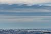 Kelvin Helmholtz Waves (kevin-palmer) Tags: february winter wyoming nikond750 sky clouds kelvinhelmholtzwaves nikon180mmf28 telephoto evening sandturn overlook windy gusty bighornnationalforest bighornmountains snow dayton