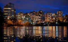 Saturday Night Lights (Clayton Perry Photoworks) Tags: vancouver bc canada winter explorebc explorecanada night lights lostlagoon stanleypark skyline reflections city