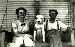 Front Porch Swing (~ Lone Wadi ~) Tags: frontporch couple dog pet animal canine outdoors retro 1930s unknown residence house